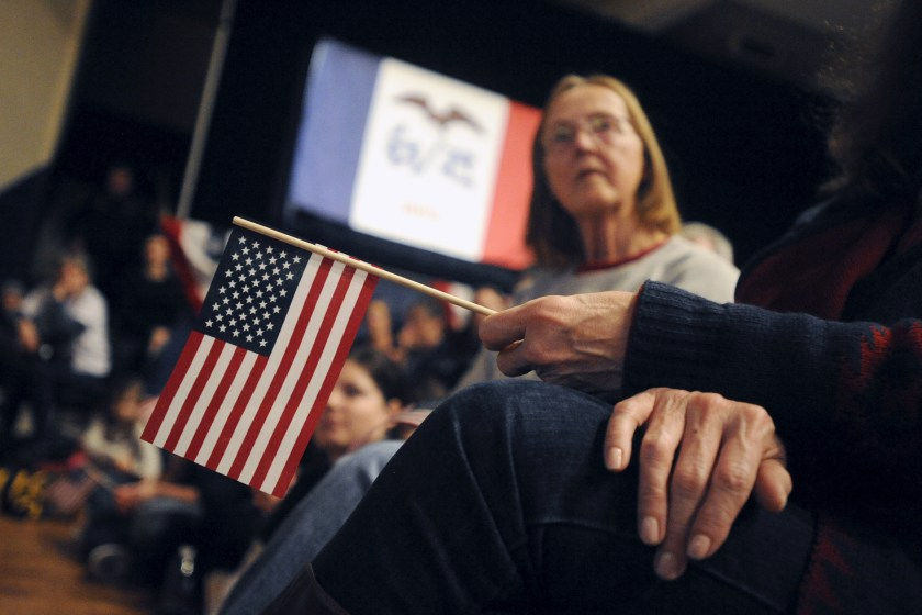 A supporter of U.S. Democratic presidential candidate Sanders holds an American flag at a campaign rally in Burlington, Iowa