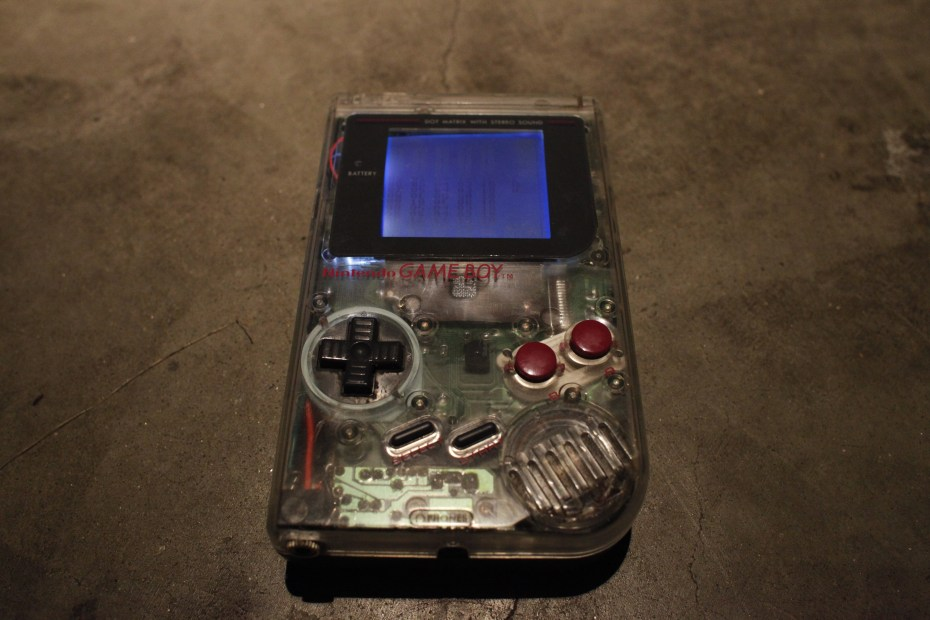 Robert Joffred AKA Kill3r Whale - Clear case, LSDJ, backlit screen, Prosound. The back is a half of a grey Game Boy dyed green with RIT dye. He used to have two, but destroyed one when its backlight failed.