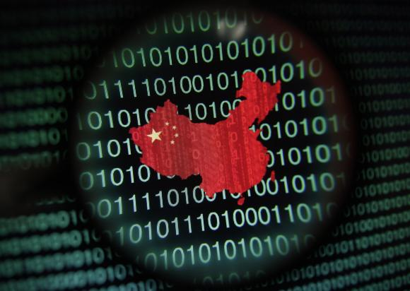 A map of China is seen through a magnifying glass on a computer screen showing binary digits in Singapore in this January 2, 2014 photo illustration. Picture taken January 2, 2014. REUTERS/Edgar Su