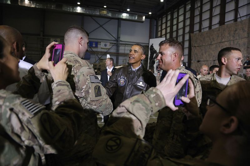 Soldiers take photos as U.S. President Barack Obama (C) shakes hands with troops after delivering remarks at Bagram Air Base in Kabul, May 25, 2014. (Reuters/Jonathan Ernst)