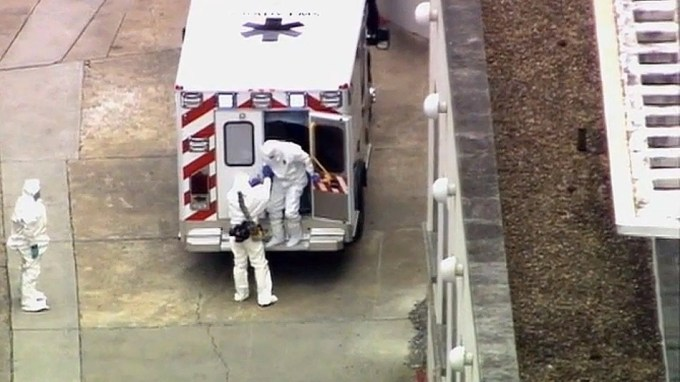An ambulance arrives with an Ebola victim at Emory University Hospital in Atlanta on Saturday, Aug. 2, 2014. (WSB-TV Atlanta)
