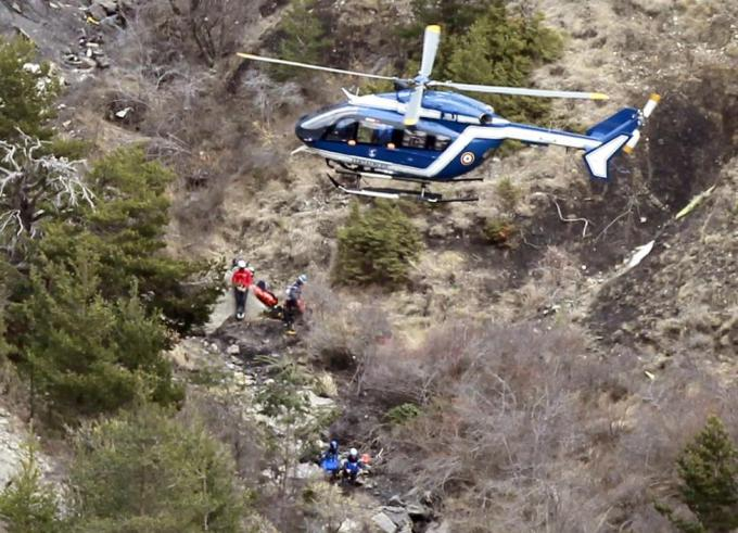 A French gendarme helicopter flies over the crash site of an Airbus A320, near Seyne-les-Alpes, March 25, 2015. French investigators will sift through wreckage for clues into why a German Airbus operated by Lufthansa's Germanwings budget airline plowed into an Alpine mountainside, killing all 150 people on board including 16 schoolchildren returning from an exchange trip to Spain. REUTERS/Emmanuel Foudrot