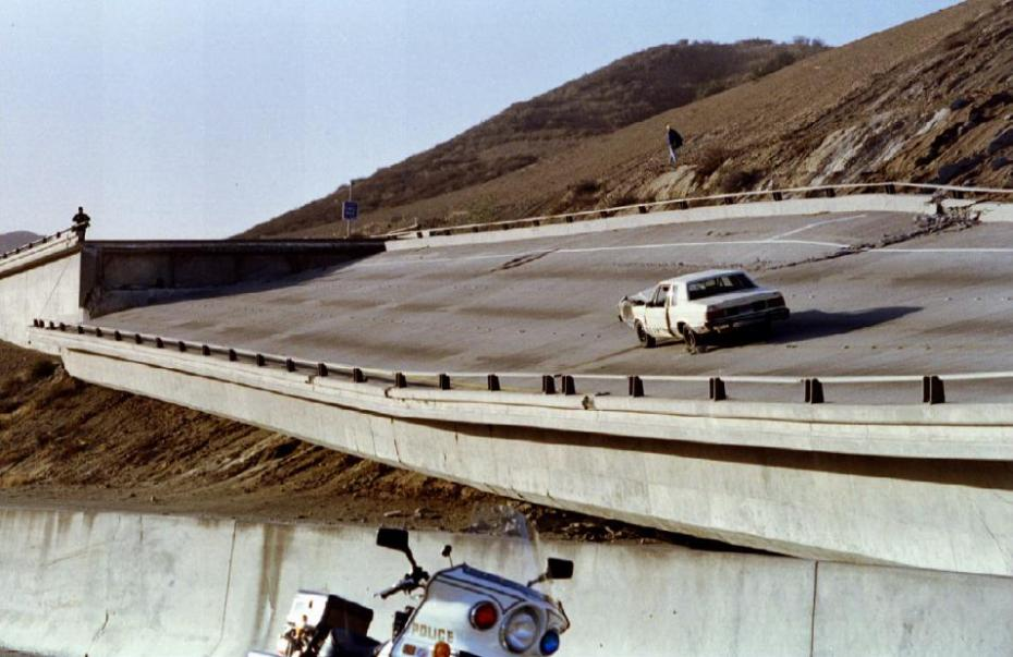 1994 Los Angeles earthquake A damaged car rests on a section of freeway near the 5 and 14 freeway connection that collapsed Janaury 17, 1994, following an earthquake hit the Los Angeles area measuring 6.6 on the Richter scale. (Fred Prouser/Reuters)