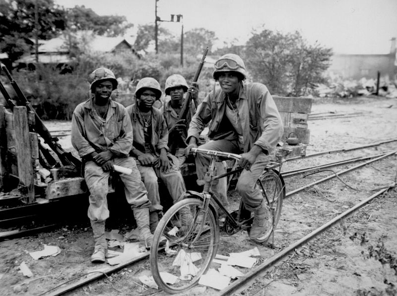 Members of the 3d Ammunition Company, part of the 2nd Marine Division, relax with a captured bicycle after the Battle of Saipan. [Wikipedia]