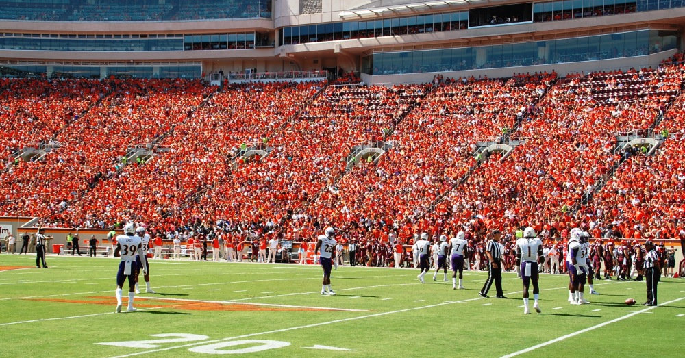East Carolina's defensive unit waits for play to resume on Saturday before a sea of orange. (Photo by Al Myatt)