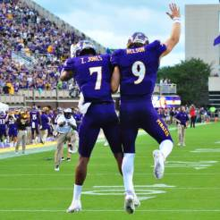 Zay Jones (7) and Philip Nelson (9) celebrate after a touchdown. The two would later connect. The duo had a strong showing in the season opener - Nelson threw for 398 yards and 5 touchdowns, completing 28-32 attempts and Jones had ten catches for 180 yards and a touchdown reception. (W.A. Myatt photo)