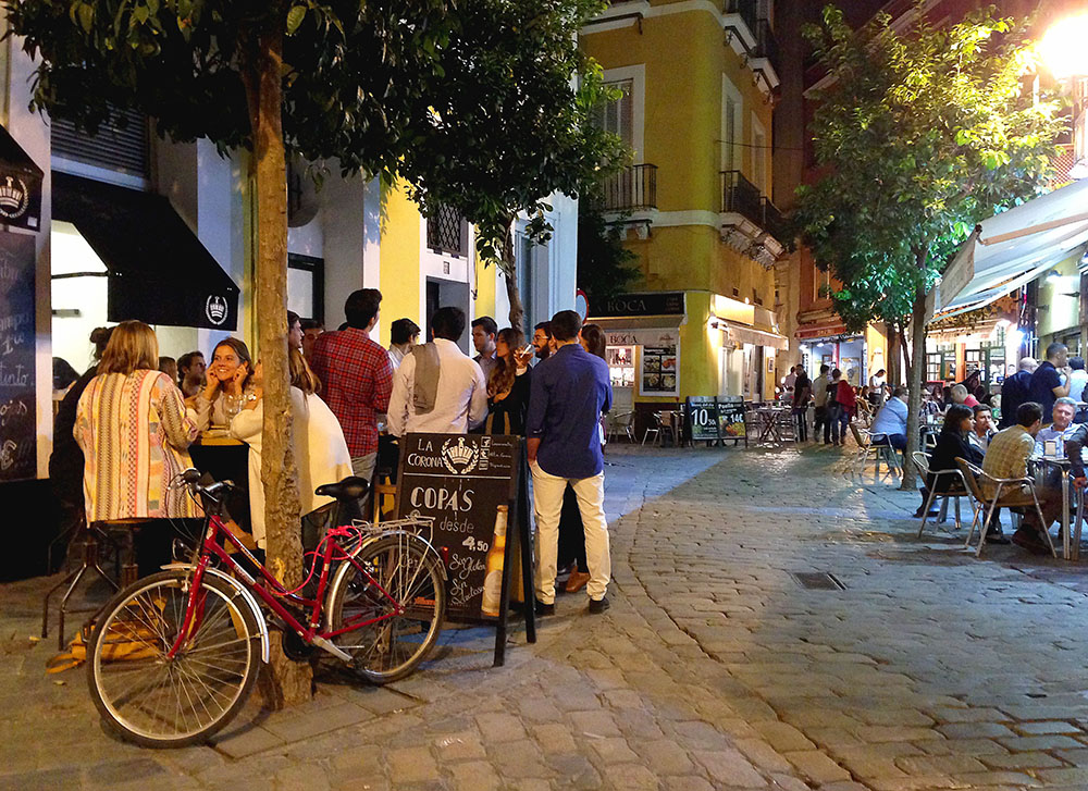 Street scene of night life in Seville