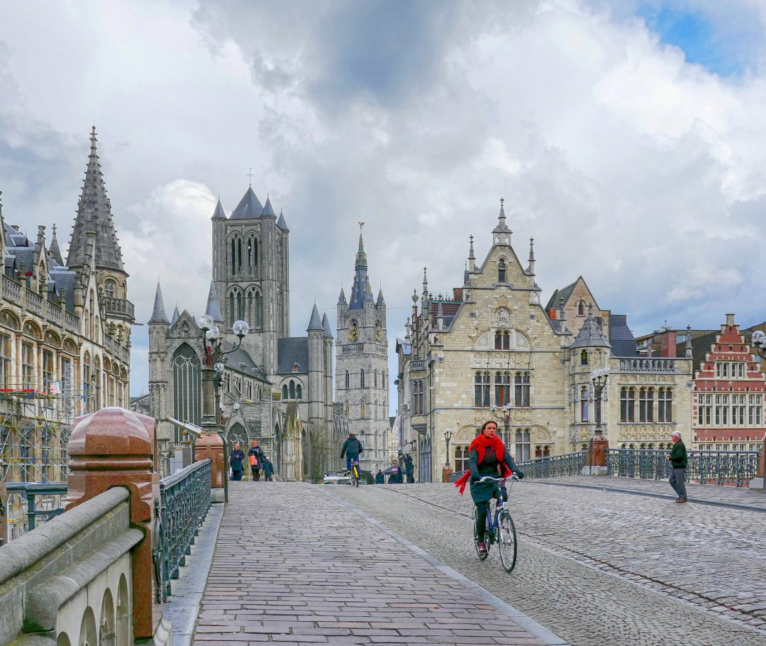 Bike riding on St Michael's Bridge in Ghent in Belgium