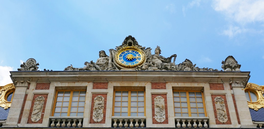 Look up to the sun to see the sun king clock at the entrance to Versialles