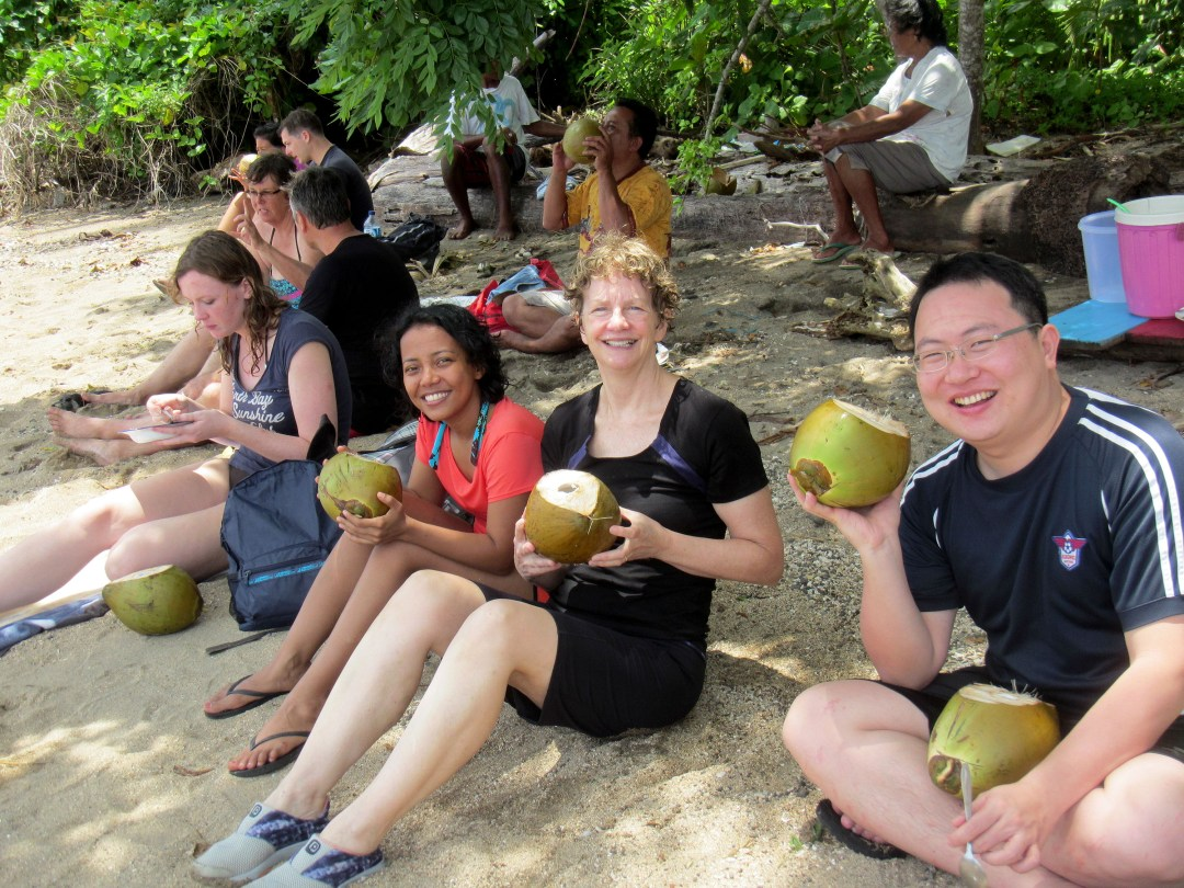 Eating fresh coconut in Bunaken