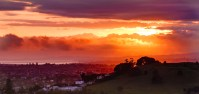 Sunrise from Mount Eden in Auckland feature image for boomervoice