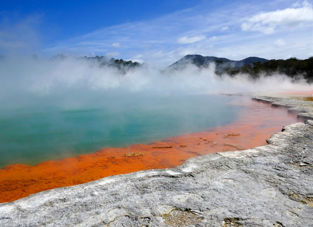 Champagne Pool and blue sky at Waiotapu Geothermal Park near Rotorua New Zealand for boomervoice