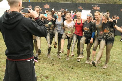 A group of my clients finishing The Stampede, a mud run