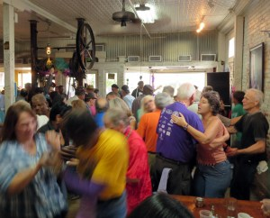 Dancers jam the tiny dancefloor at the Zydeco Breakfast at Cafe Des Amis in Breaux Bridge. Credit: Wendy Lemlin