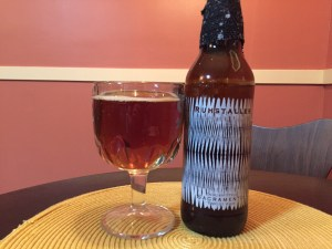 Ruhstaller DiGregorio English Style Sacramento Barleywine poured in a beer goblet.