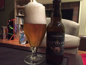 Crooked Stave Hop Savant Brettanomyces IPA poured into a tulip beer glass.