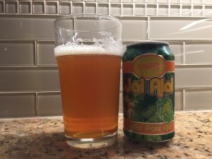 Cigar City Brewing Jai Ali IPA poured into a nonic pint glass.