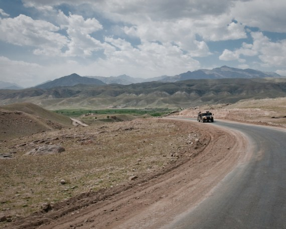 KAPISA PROVINCE, Afghanistan (March 30, 2010) —A humvee of the Afghan National Army traverses a solitary road through the Tagab Valley. (U.S. Navy photo by Petty Officer 1st Class Mark O'Donald/Released)