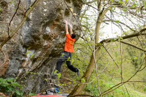 David Mason climbing the FA of Candy Man Sit Start 8A