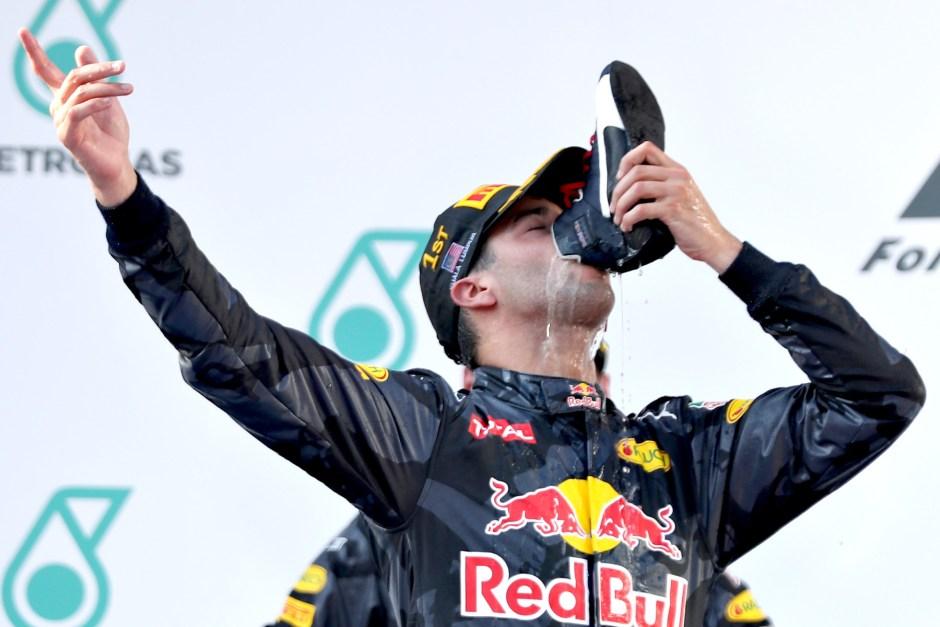 Daniel Ricciardo engaged in his now-trademarked shoey on the Malaysian GP podium.