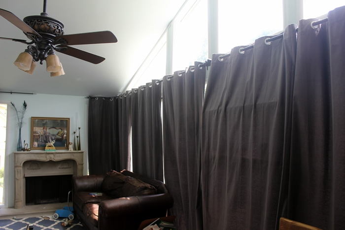 curtains pulled closed over shelf