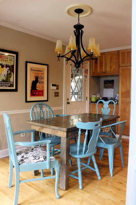 mismatched chairs around kitchen table
