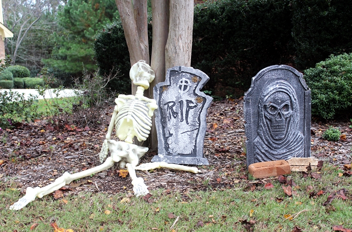 Halloween graveyard with skeleton