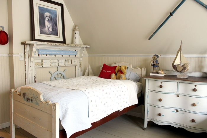 Nantucket kids' room with antique bed