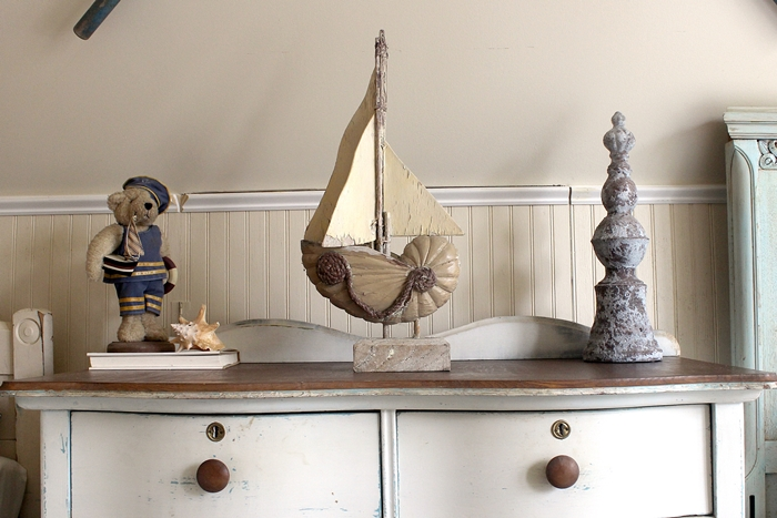 ocean themed vignette on dresser