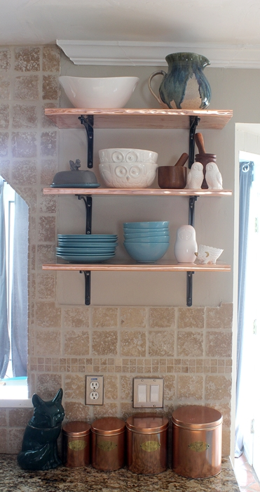 copper shelves in kitchen