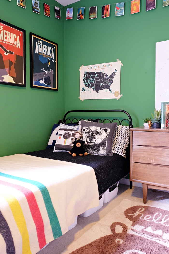 National Parks themed boys room with pillows and poster from Uncommon Goods