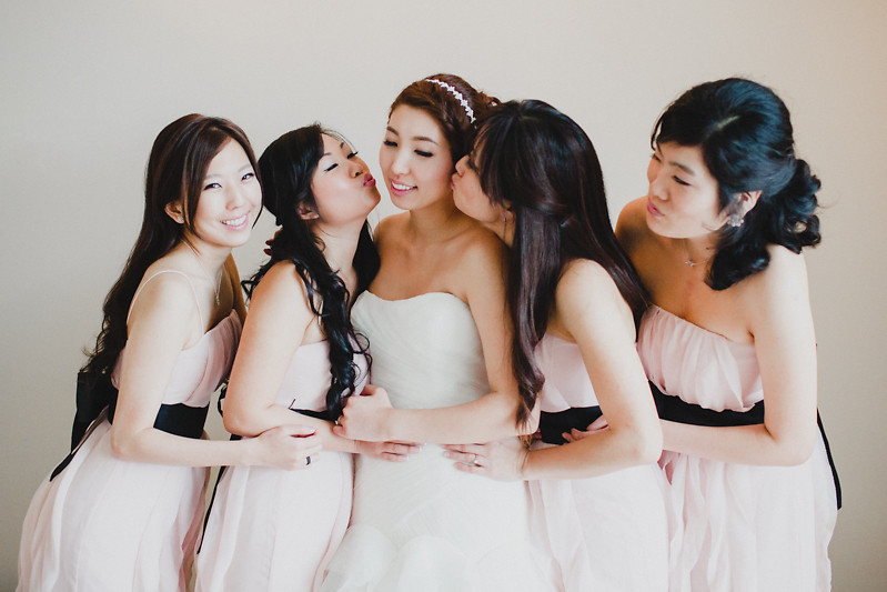 bridesmaids kiss bride