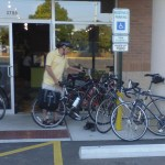 Mike finding parking at donut shop post ride