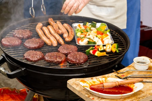 Burgers and sausages on barbecue
