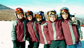 Skiing, and learning, with friends if more fun. And no, you don't have to have matching coats!