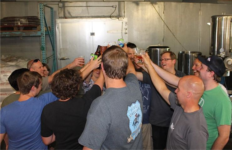 Brewers cheers one another during the industry bottle share.