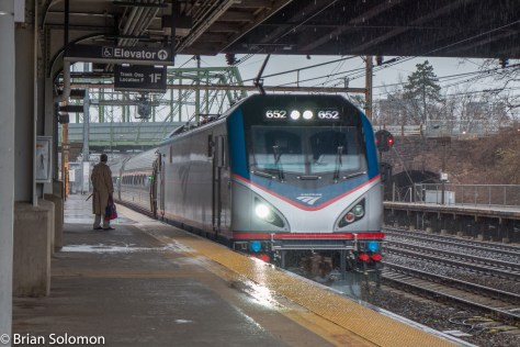 Amtrak ACS-64 652 leads Keystone train 648 east at Trenton, New Jersey in a December 2015 downpour. Digitally exposed using a Lumix LX7.
