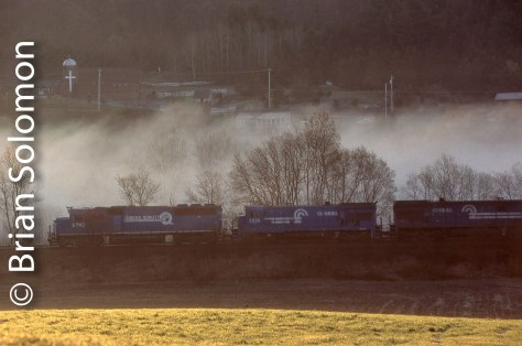 Conrail TV10B emerges from the mist enshrouded Quaboag River Valley near CP79 east of Palmer, Massachusetts. It was scenes like this one, exposed on April 30, 1997, that made Conrail a favorite railroad. Nikon N90S with 80-200mm Nikkor AF zoom, Ektachrome film.
