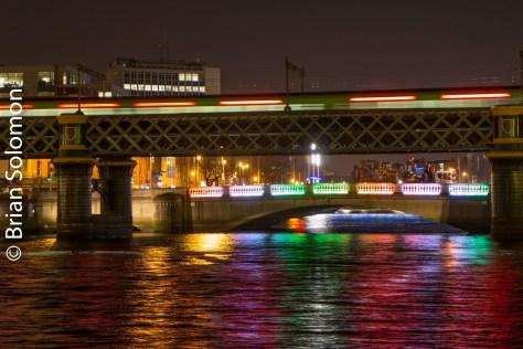 The DART crosses the Loop Line Bridge over the Liffey.