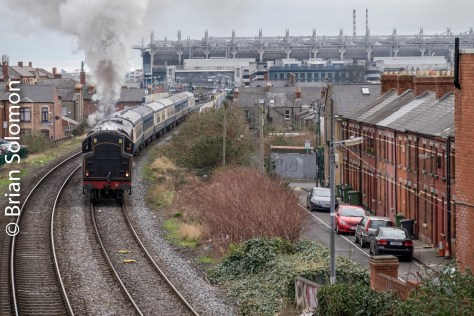 Using my 18-135mm zoom lens, I pulled back as the locomotive approached.