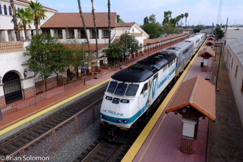 A Metrolink F59PHI works at the back of Los Angeles bound train number 687. Here my Fujinon 18-135mm lens gave me a nice view of the train and station from the footbridge.