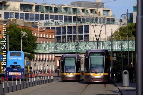 Red Line LUAS trams pass near the Loop Line Bridge on Abbey Street. The new crossing on Marlborough Street is behind me.