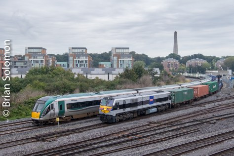Irish Rail's IWT Liner with 201-class diesel 231 decorated for IWT passes Islandbridge Junction at 9:49am on 10 October 2016.