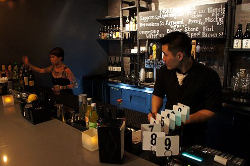 Co-owner Stanley Lin with bartender Amy prepare for dinner opening