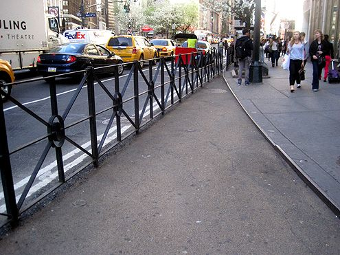 This railing separates pedestrians from the traffic