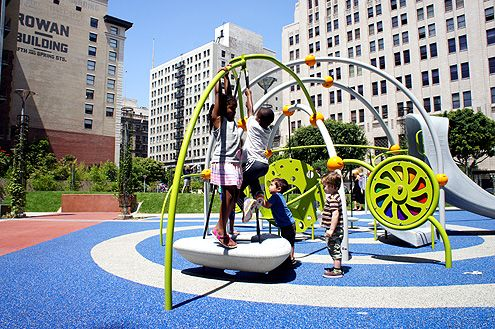 Downtown kids enjoying the new playground at Spring Street Park