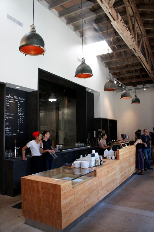 Super high ceilings accentuate the industrial character of the new Stumptown in the Arts District