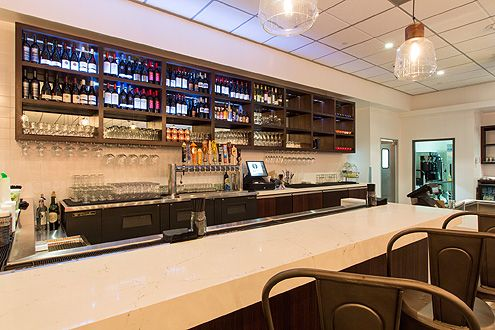 Bar in the back of restaurant offers wine, cocktails, and about a dozen beers on tap (Photo: Hunter Kerhart)