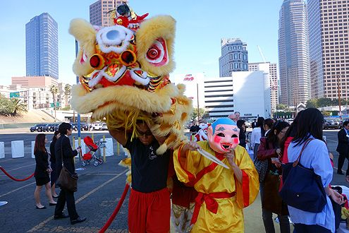 Chinese lion dancers celebrate the ceremonial ground breaking at the Metropolis site in Downtown LA