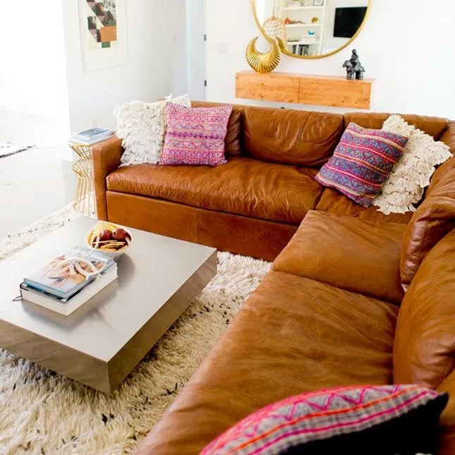 9 Ways To Rock The Leather Sofa Trend That S Taking Over Instagram Brit Co